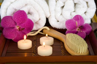 dry skin brush with candles and orchids on tray
